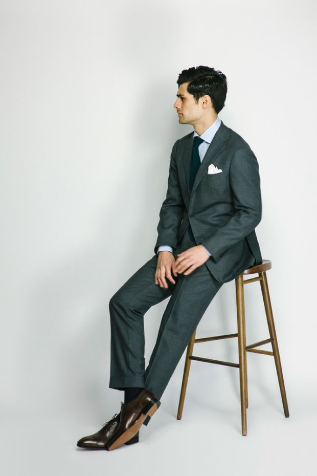 Charcoal suit, light blue shirt, brown shoes.