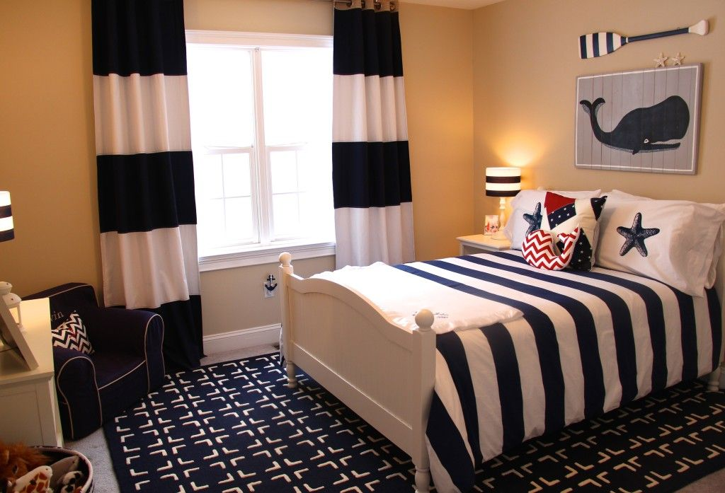 Navy rug - perfect in this little boy's nautical room! #bigboyroom #nautical