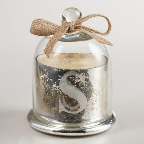 """In a vintage-inspired silver mercury glass jar with a glass cloche lid, our filled vanilla-scented candle is etched with the initial """"S"""" and comes wrapped with a jute bow for instant, personalized gifting."""