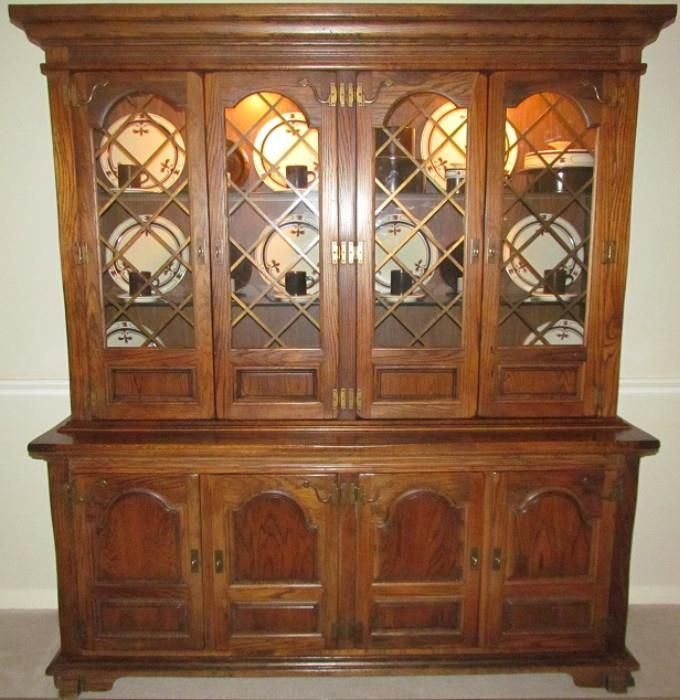 Ennius Interiors Of Boise Idaho Solid Oak Veneer Buffet Lighted Hutch The Kensington Place Style Deeply Carved And Sculptured Reflects Splendor
