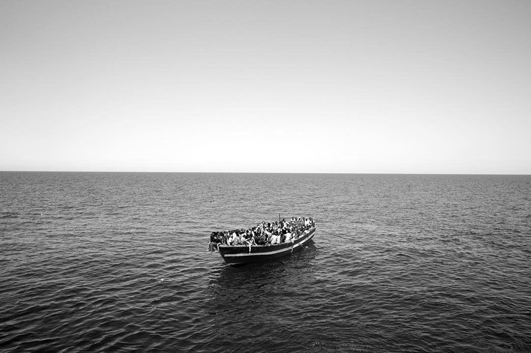 Looking back at 2015 for International #MigrantsDay. #Eritrean migrants are seen in their boat as they are about to be rescued by Medecins sans Frontieres September 2015.  #PaoloPellegrin/#MagnumPhotos.