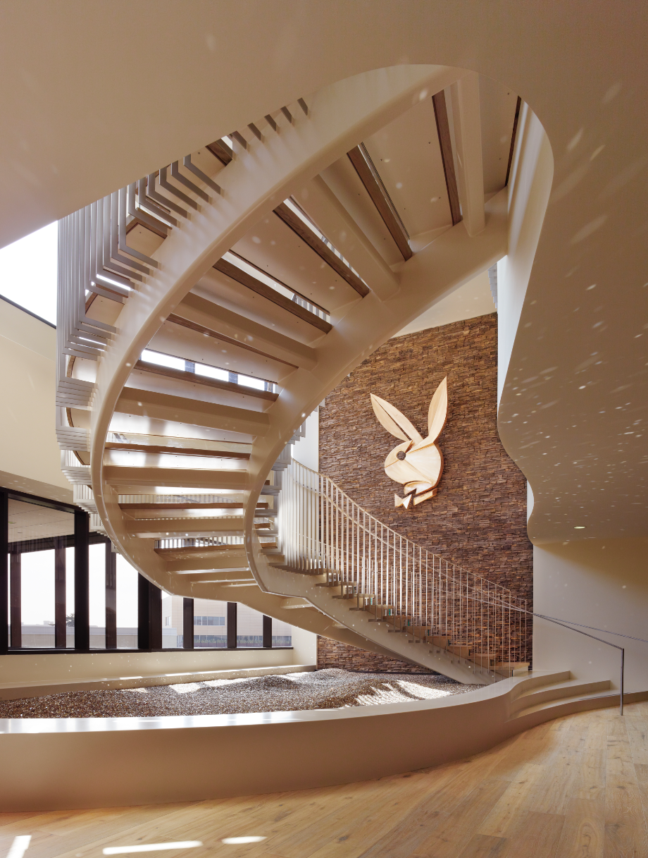 Wolcott Architecture Interiors completed a project for Playboy's corporate office. DuChateau Floors in Riverstone Danube were installed to create a contemporary yet warm feel in the Beverly Hills, California space.  Photo credit: DuChateau Floors in Playboy Corporate. Design by Wolcott.