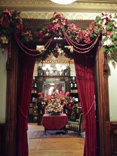 Victorian red Christmas decorations at The Glenview Mansion at The Hudson River Museum, Yonkers, NY