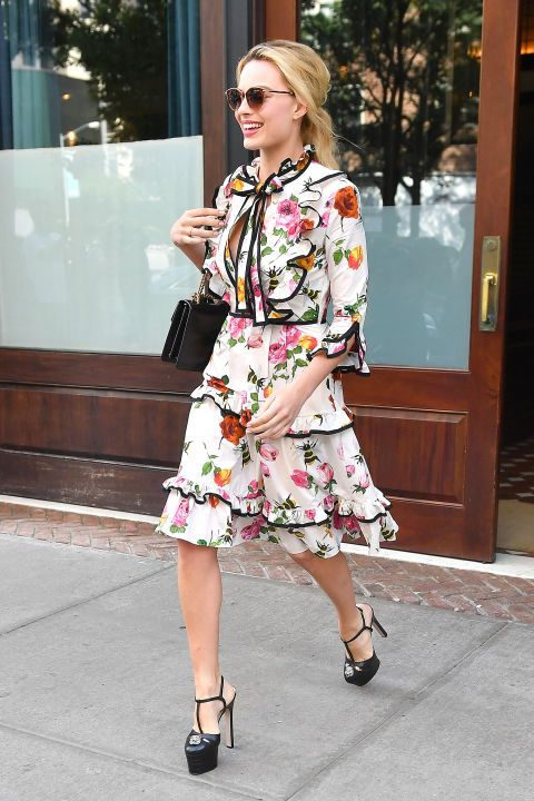 Who  Margot Robbie What  A Tiered Floral Dress Why  Robbie s flirty Gucci  dress ups the ante with tiered layers for extra movement while she s on the  go. 34b6c178398