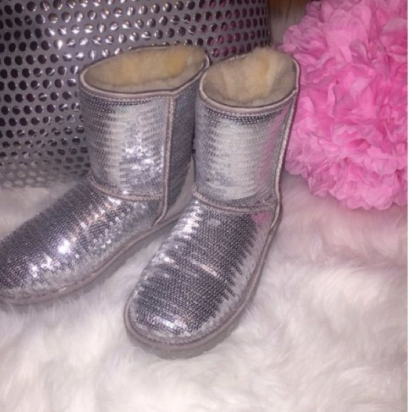 Silver short sparkly UGG boots In perfect condition! A kids 5 but fits a women's 7. Selling for my sister! Final price. Won't send in original box because of shipping price. UGG Shoes