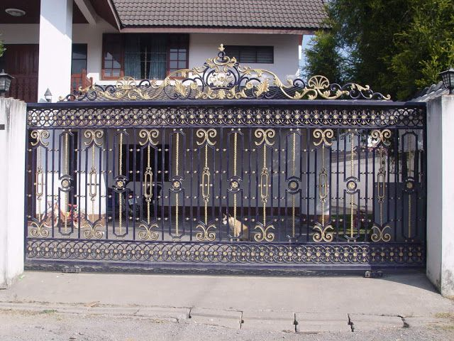 Exclusive modern iron gate designs for villas entrances  its glided black  iron gate paints designs with small iron door and one slide iron gate  design with. iron gates for reference   Kerala home   Gates   Pinterest   Iron