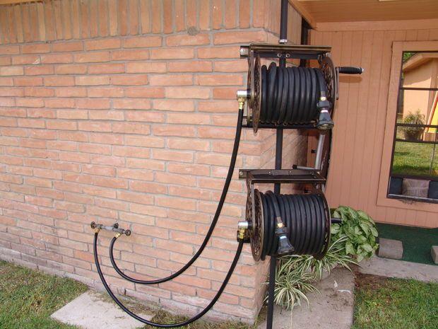 Dual Swiveling Pole Mounted Garden Hose Reels Gardening