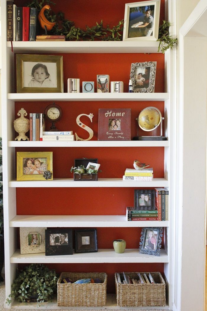 Bookcase Decoration With Red Accent And Book