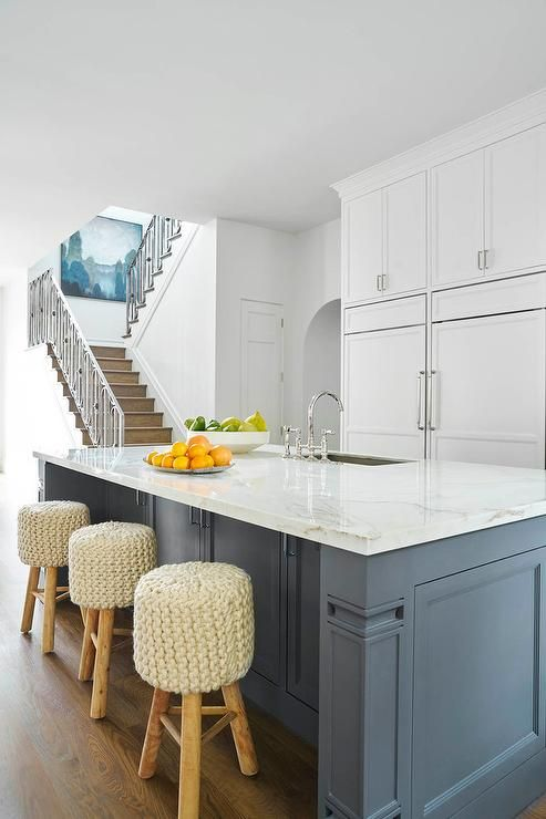 a slate blue kitchen island is topped with white quartz fitted with a sink and deck mount faucet on kitchen island ideas white quartz id=55988
