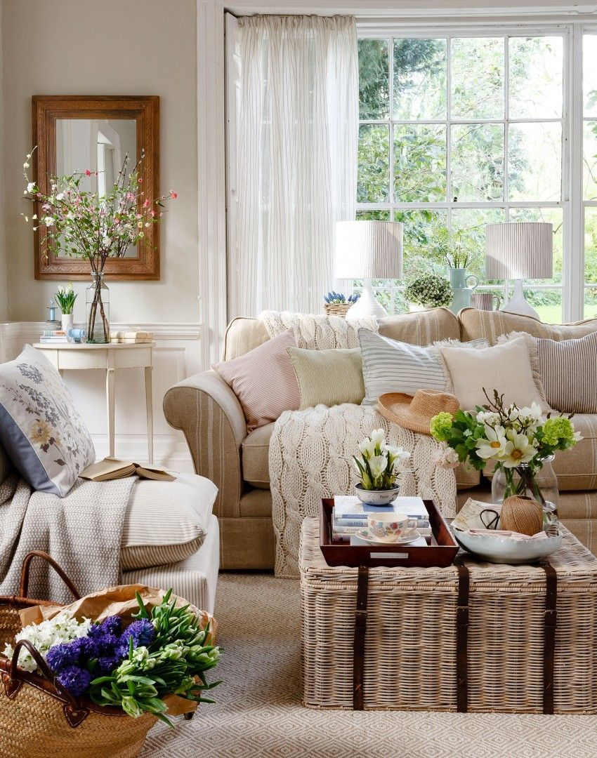 Neutral traditional living room with wicker trunk for Country style family room ideas