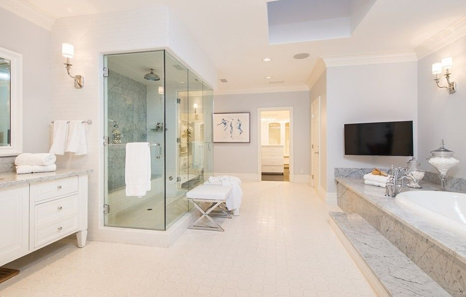 Spacious and open, this luxurious en-suite bathroom offers a large ...