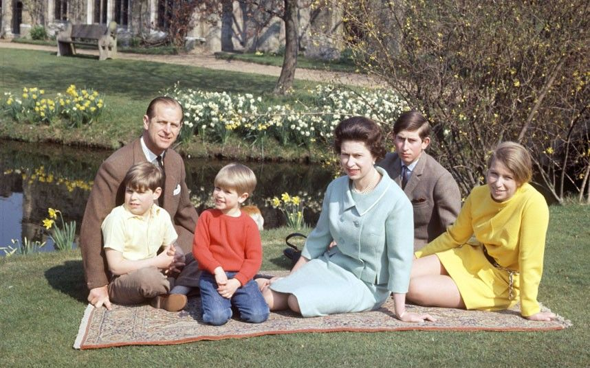 1968: The Queen and Prince Philip, and their children Andrew, Edward,  Charles and Anne, sit on the lawn at Frogmore, Windsor