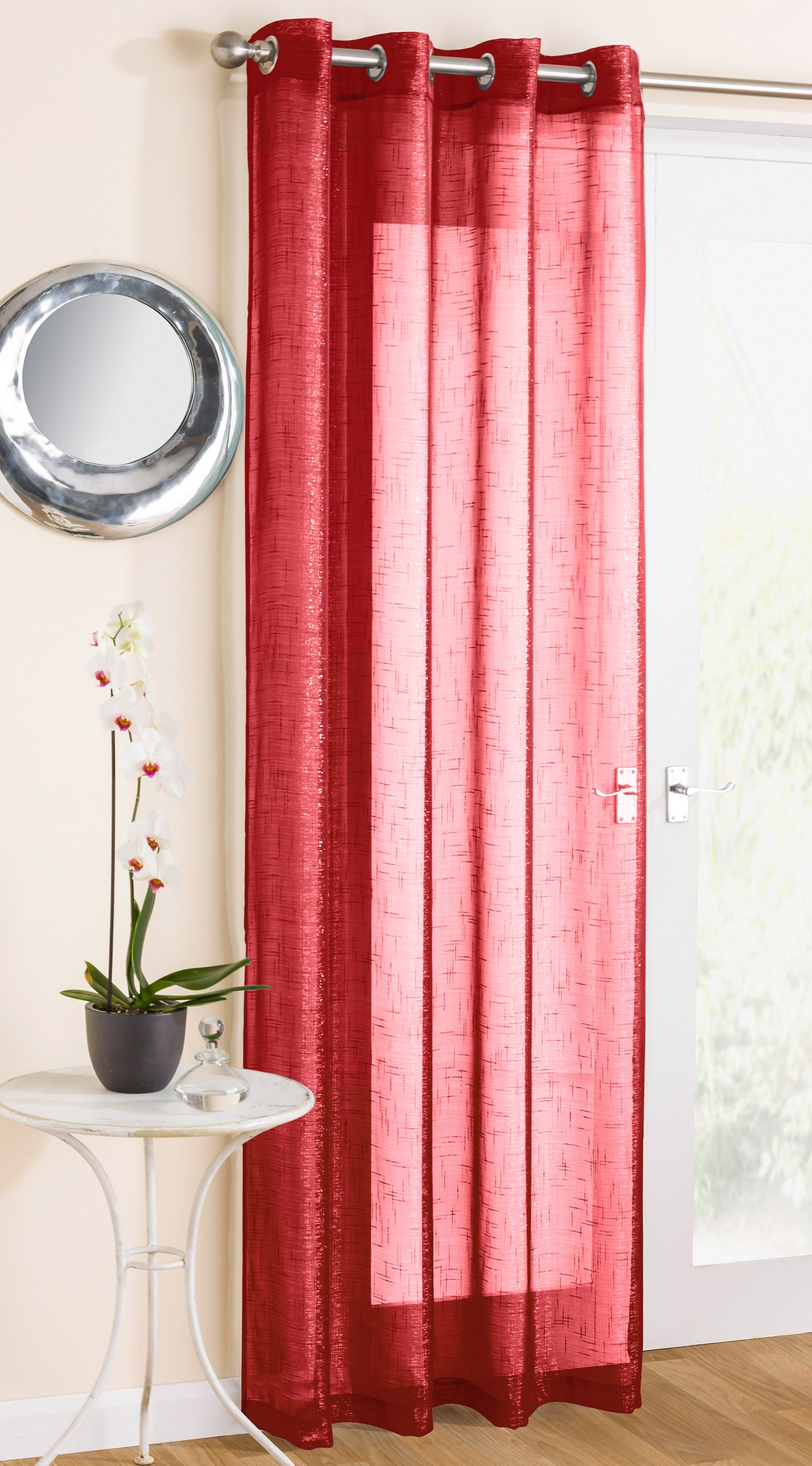 Marrakesh Red Eyelet Voile Panel, A modern and sparkly red voile panel with a slight glitter slub and a eyelet heading, suitable for all poles and rods