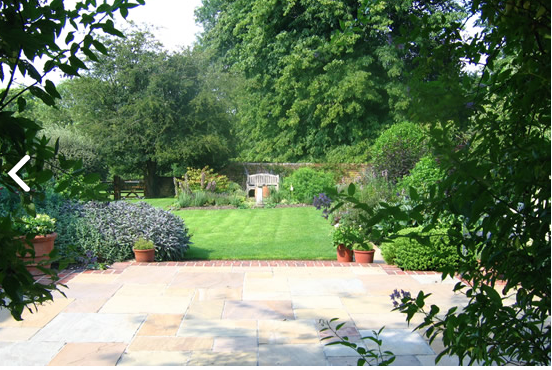 seat at end of garden boundary with duck pond in front | garden ...