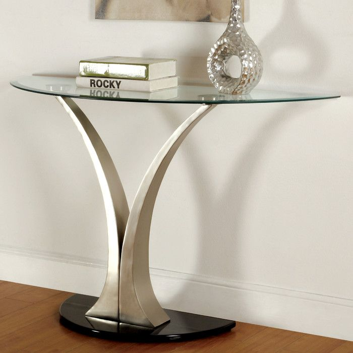 Shop Joss & Main for your Lexi Console Table. Gracefully sophisticated, this modern sofa table will bring any space up to date. An oval tempered glass table top rests upon curving metallic pedestals, creating visual interest in any room.