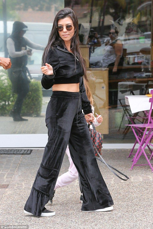 Showing off her Cannes tan: The 38-year-old reality star donned a black velour tracksuit a...