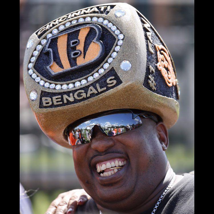 8f63c97781c03e Bengals fan Cornell Jones shows off his Super Bowl ring hat during  Cincinnati Bengals training camp
