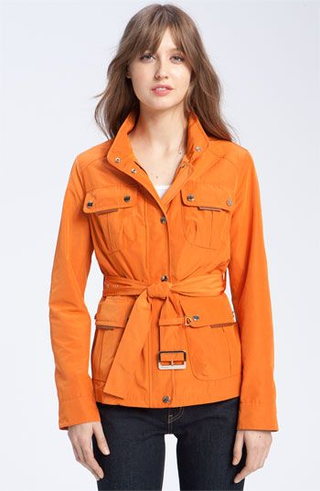 Burnt orange belted jacket by Tumi... great pop of color for the spring!