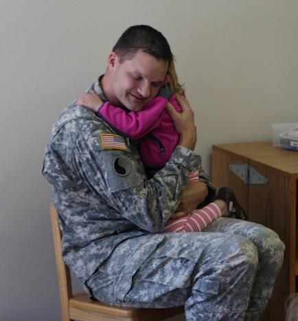 Major May 1 252 Bn Xo Shares A Moment With One Of The Little Ones During The Month Of The Military Child And Later Presents C Military Kids Children Military