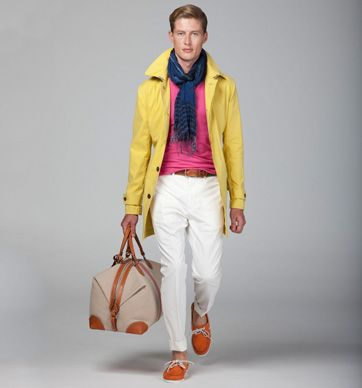 Cotton mac in yellow | Cotton and cashmere pullover in pink | Linen and wool stripe scarf in navy | Cotton Sanderson trousers in ecru | Woven belt in navy | Cotton and leather holdall in ivory, tan and red | Leather deck shoes in orange