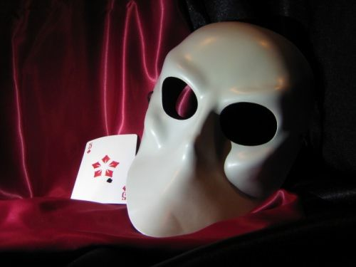 """This is the mask you wear, a sample of the playing card you'll get when attending the awesome interactive theater experience at Sleep No More in New York City."""
