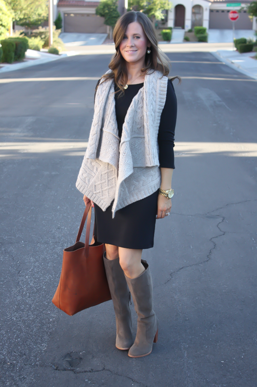 black long sleeve dress, grey vest, grey suede boots, and tote ...