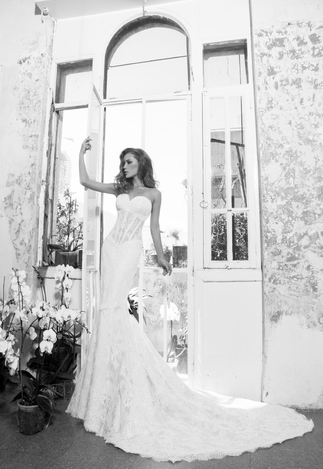 Spectacular LOVE by Pnina Tornai Sweetheart Fit and Flare in Lace This fit and flare features a sweetheart neckline with a natural waist in lace It has a chapel train