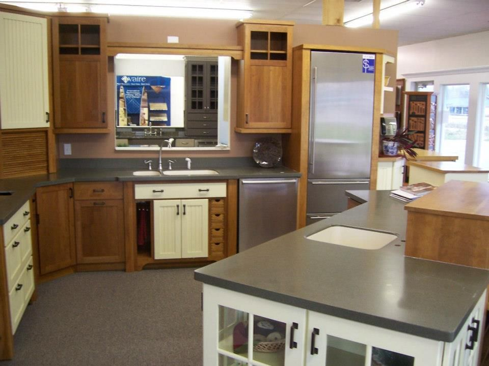 Adding a splash of accect color to your cherry wood kitchen makes a bold statement and makes it one of a kind
