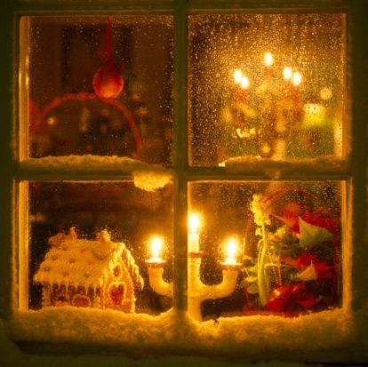 Christmas Decorations Through The Window At Night