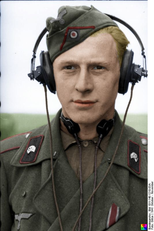 SS Sturmgeschütz commander on the central Russian Front. He's wearing radio operators equipment...