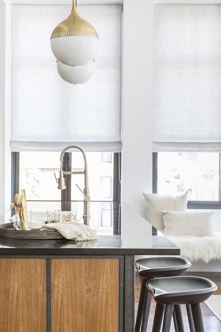 Modern sleek kitchen design with dark countertop and stools   Sissy ...