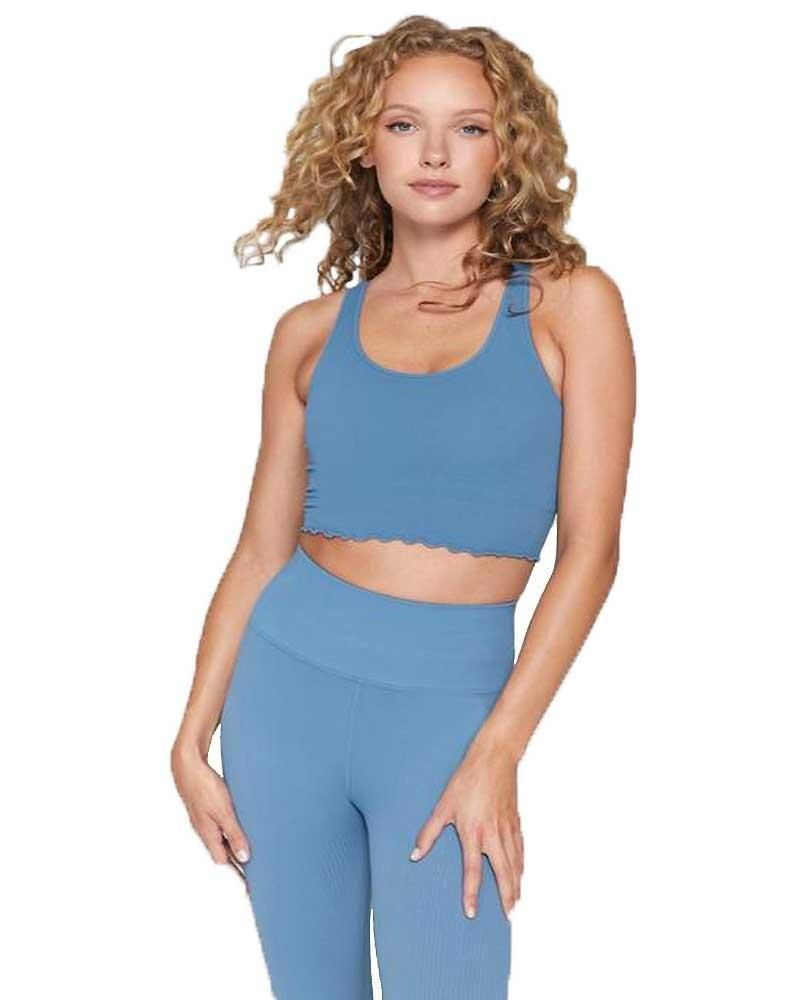 Spiritual Gangster's Amor Crop Tank is your perfect summer look with a scoop neck, built-in shelf bra, and lettuce-edged hem. Made from soft, supportive seamless ribbed fabric that's quick-drying and moisture-wicking. Made in the USA. Specs Material: Nylon/Spandex blend Length: Cropped Breathable: Yes Wicks Moisture: Yes Bra Shelf: Yes Removable Cups: No Support: Medium Made: USA Fit: Fitted Activity: Yoga, dancing, walking around town