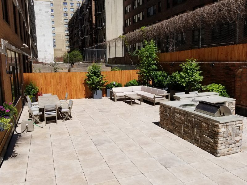Rooftop garden in NYC with porcelain pavers and outdoor ...