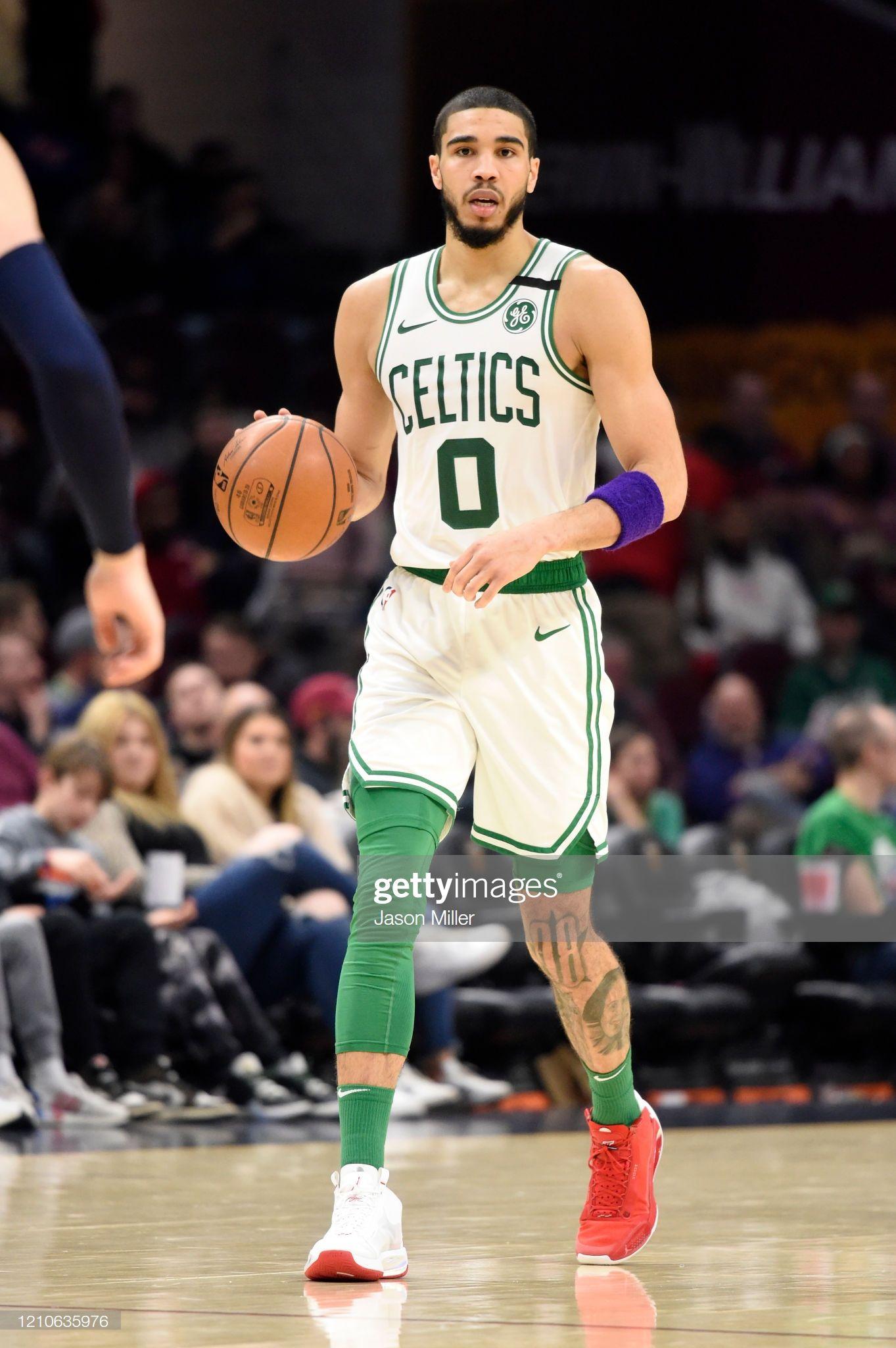 Jayson Tatum of the Boston Celtics drives down court
