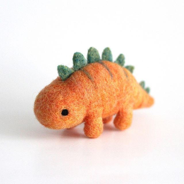 I tried making my Stegosaurus in another colour combo and just noticed he kinda looks like a carrot. Haha oops! . . . #stegosaurus #dinosaur #dinolove #dinosaurlover #dinolife #dinosaurart #dinosaursrule #jurassicworld #prehistoric #instaart #kawaiiart #arttoy #figurine #softsculpture #abmcrafty #fibreartist #torontoartist #wildwhimsywoolies