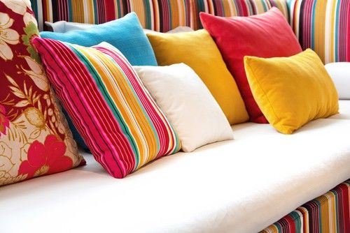 pillows colors home decor--I like the idea of having throw pillows in fun colors, patters, designs on a sofa.