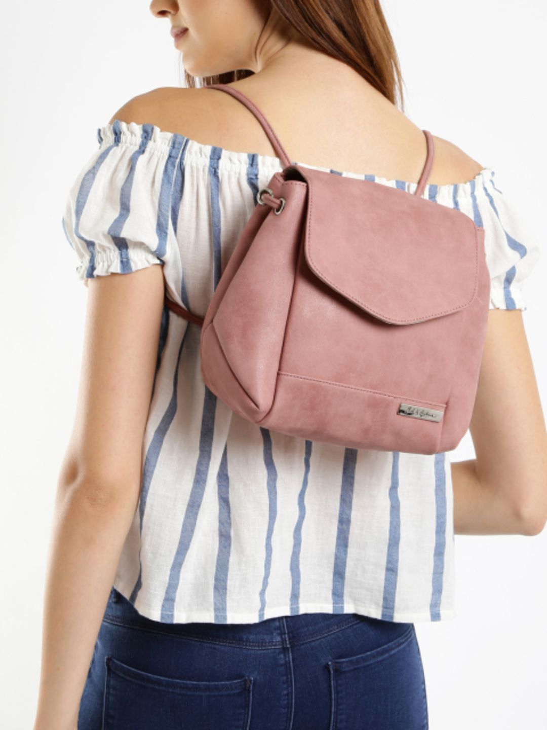 f5daf2d2a8ba90 Pink backpack cum sling bag, has a flap across the mouth secured with a  magnetic button closure One long sling strap that can be converted to  shoulder ...