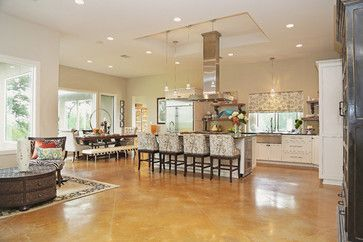 The Warm Stained Concrete Floors Keep Contemporary House Not Too Cold This Home Light With White Cabinets And Open E