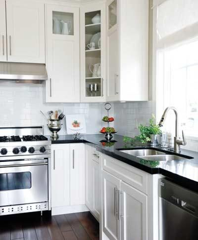kitchens - black granite countertops white glass-front cabinets