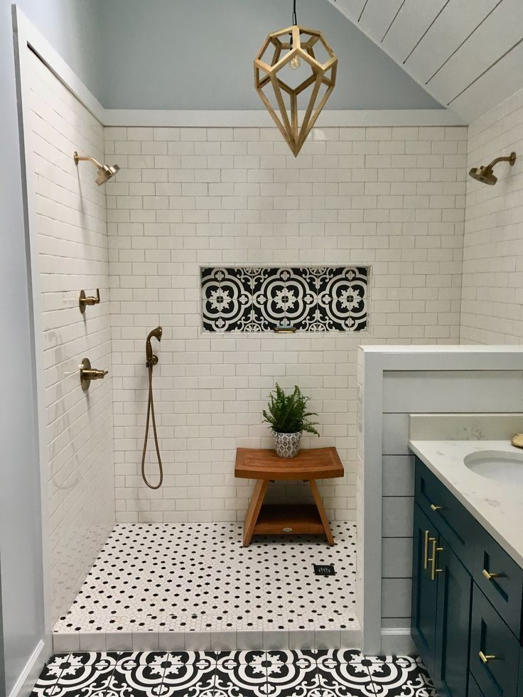 Photo of Large dual head shower. White subway tile. Black and white patterned tile. Champ…