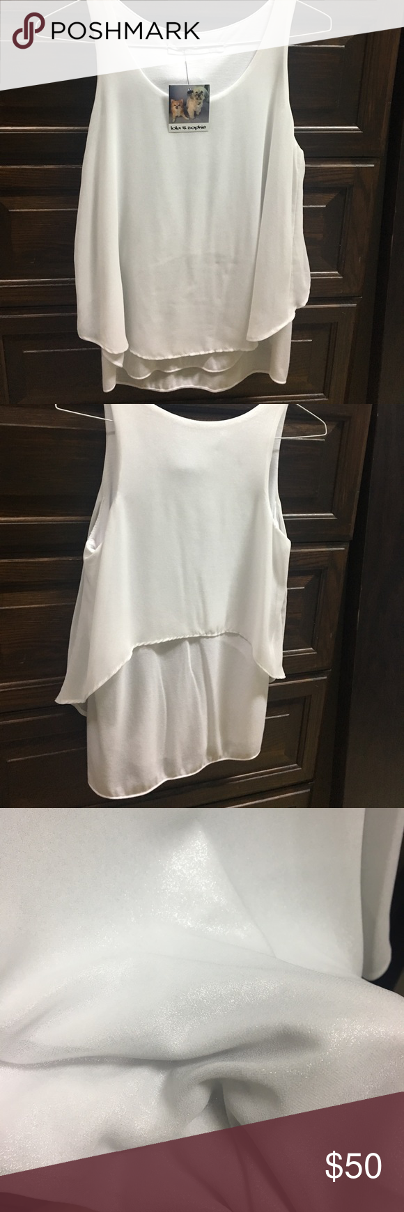 LOLA AND SOPHIE | double layered white tank Never been worn. Can be dressed up or down. Has a sparkle to it on the top layer and bottom layer is a soft cotton. lola and sophie Tops Tank Tops