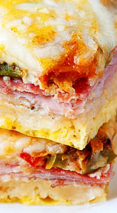 Italian Breakfast Casserole - Layers of salami, ham, eggs, bell peppers, onions and cheese make this the perfect breakfast, lunch, or breakfast for dinner!