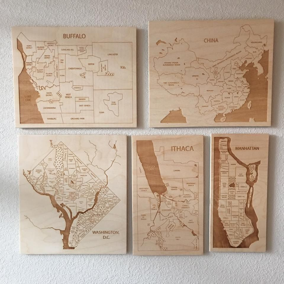 Map Wall featuring engraved wood maps from