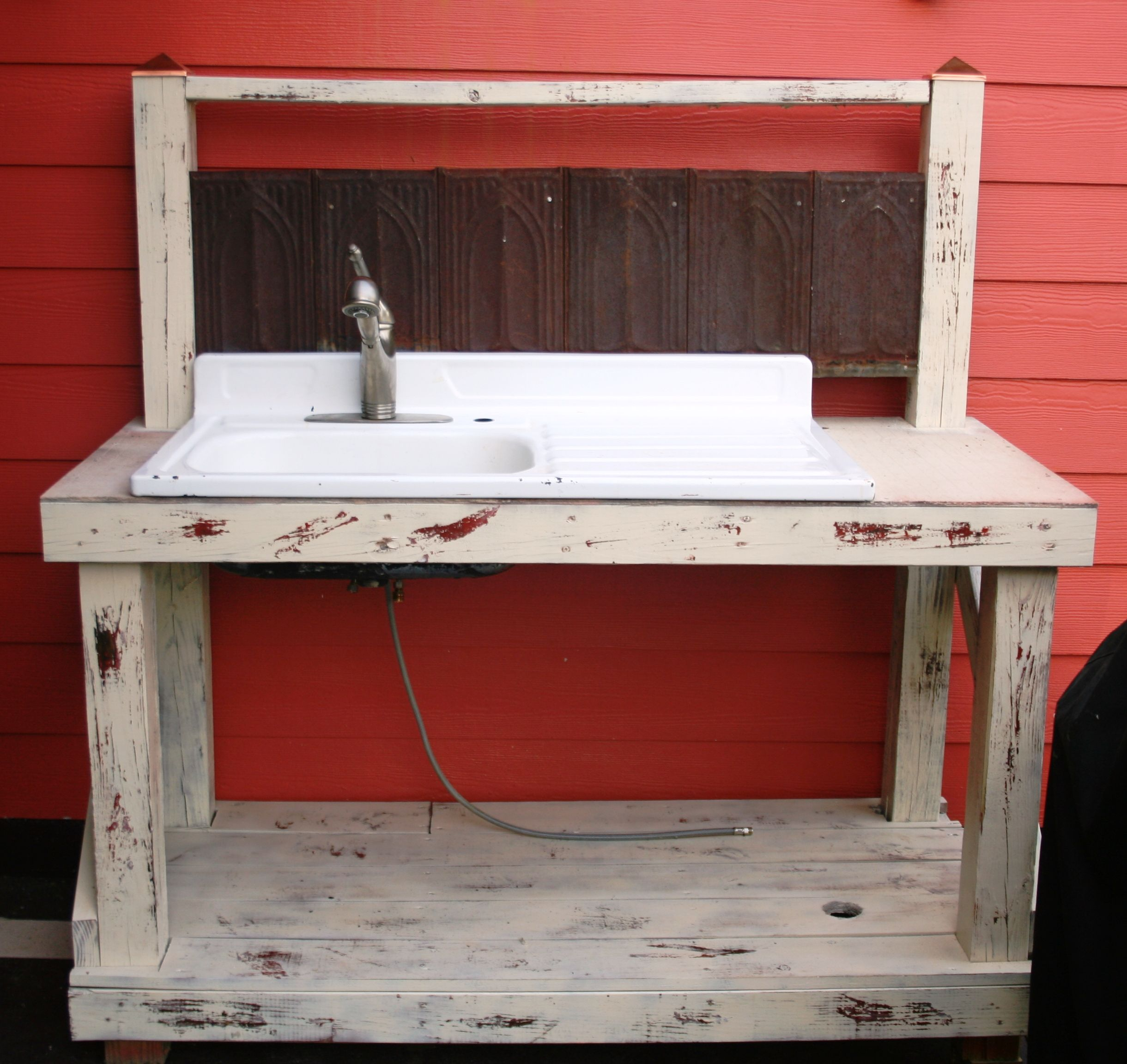 My Hubby Built This Outdoor Kitchen For The Back Porch We Found Old Tin From A Church Old Sink From His G Outdoor Kitchen Sink Outdoor Sinks Outdoor Kitchen