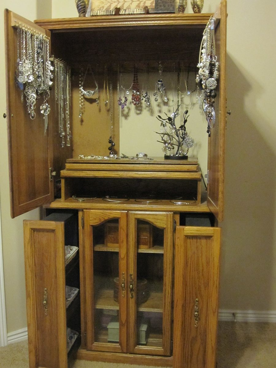 Old entertainment center converted to giant jewelry box Jewelry