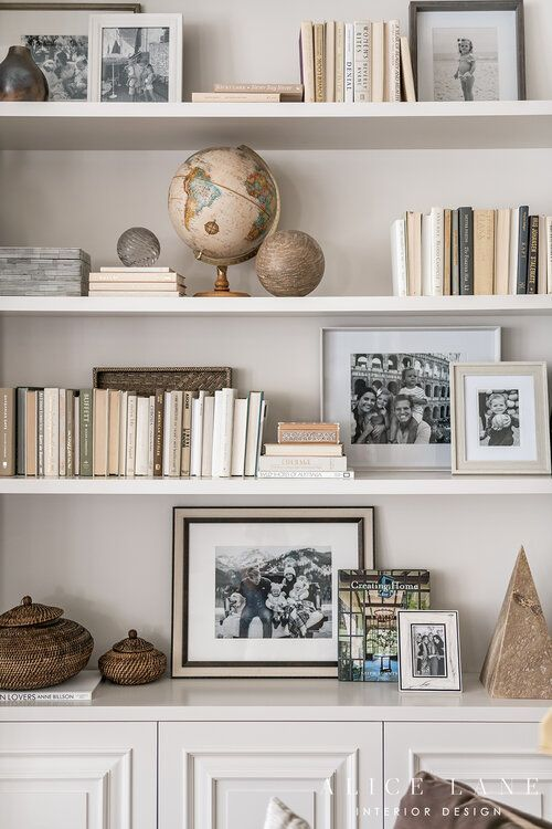 Love this shelf styling! How to style books, photographs, picture frames, and objects on shelves or bookshelves. Lovely neutral colour scheme. PARCELL HOME — ALICE LANE INTERIOR DESIGN