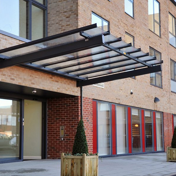 Architectural Canopies Is A Respectable Name When It Comes To Choosing From A Wide Range Of Metal Building Coverings Glass Awning Canopy Building Front Canopy