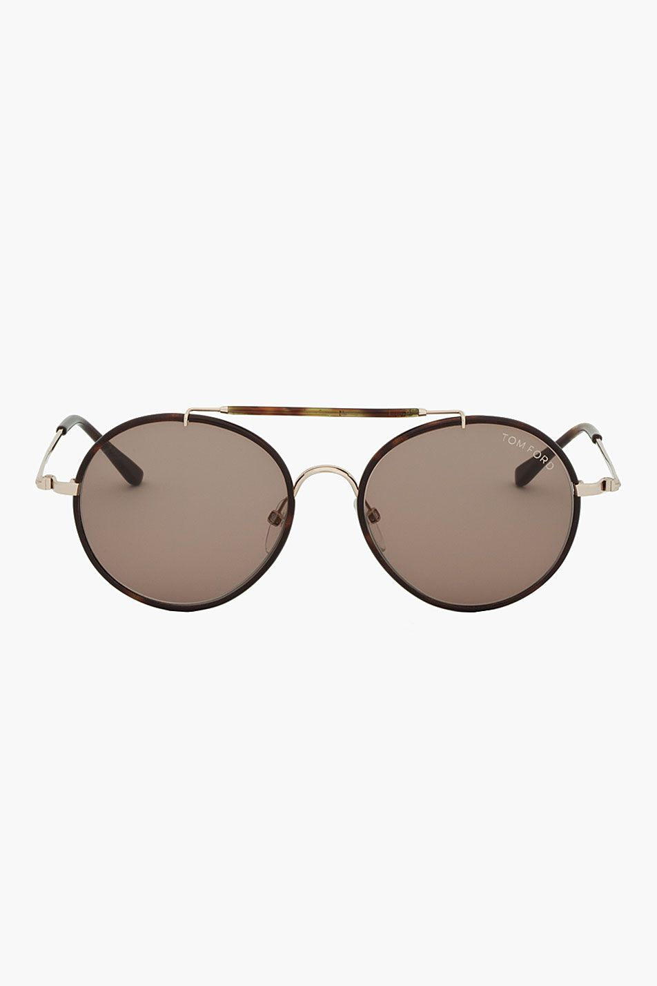 TOM FORD // Brown Camo FT0246 Teashade Sunglasses 31076M013003 Round thin frame teashade sunglasses in black and brown camouflage. Gold tone hardware. Metal nose bridge. Metal top bar with tonal plastic detail. Tonal plastic temple tips. Metal logo piece at temple tips. Logo print at temple interior in white. Size: 53.17 145. Made in Italy. $540 CAD