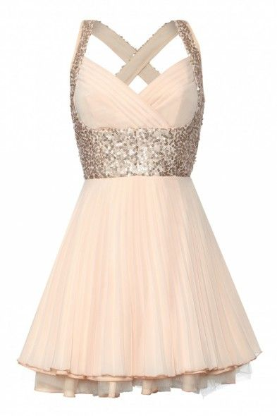 £75.00 jones and jones Nina Dress/ Peach Sequin: Shimmer in soft peach pleats and sequins in this gorgeous statement dress. Gentle pleats flow from the fitted waist and frame the bust on the structured bodice while the criss-cross back allows a glimpse of summer skin.