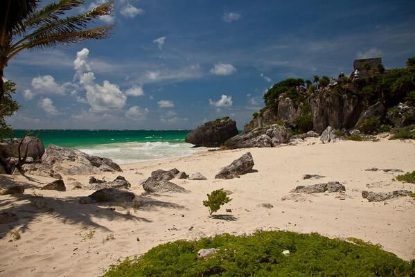 There are beach clubs located along the Tulum beach road, where you can use their parking, restaurant and beach chairs for the mere cost of a lunch.